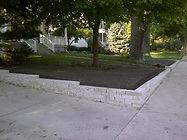 flagstone retaining wall concrete patio seating wall landscaping hydroseeding