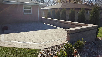 raised paver patio with seating wall