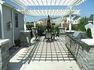 out door kitchen pergolas patio stone pillars granite counter tops maintenance free hydroseeding