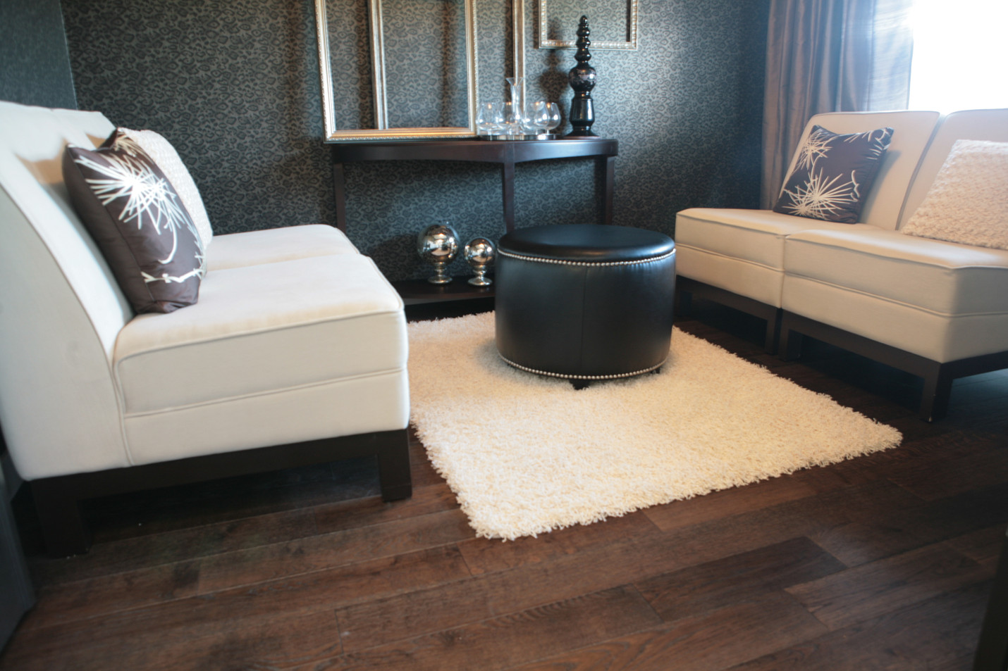 Dark hardwood flooring gives this space a whole new level of sophistication.