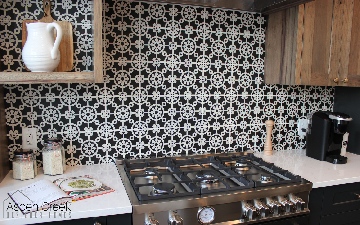 Stunning patterned cement wall tile with bold design for this modern kitchen.