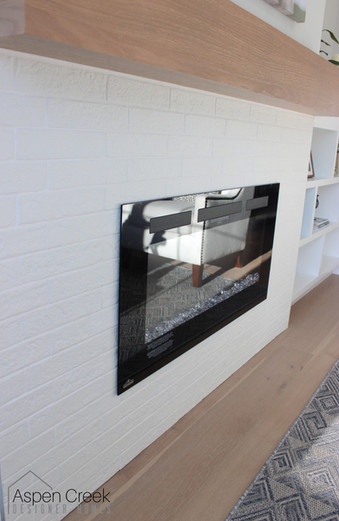 Clean and simple white tile for this fireplace.