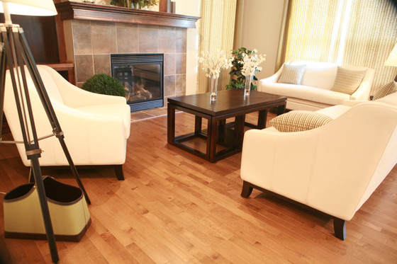 This natural hardwood in this crisp and clean living room.