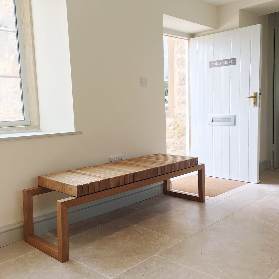 Oak and steel bench made in holloway