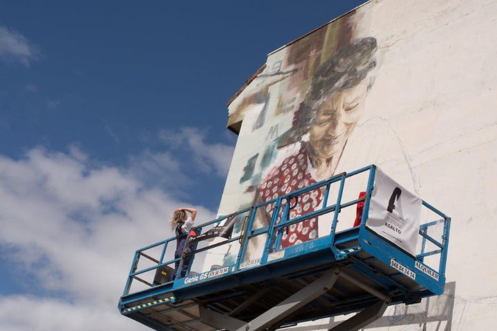 Helen Bur Painting a Mural at Asalto Festival