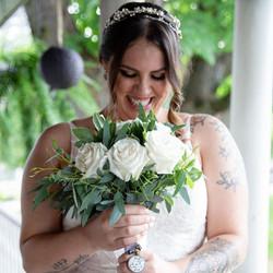 bride holding flowers makeup made eazy