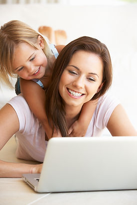 Young woman with girl using laptop compu
