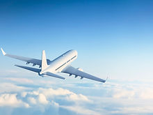 0_Commercial-jet-flying-over-clouds.jpg