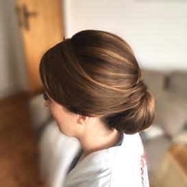 Sleek low bun hairstyle