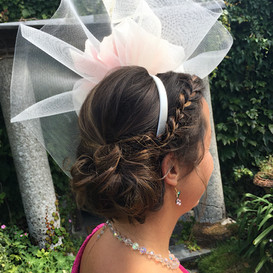 Side bun with plait hairstyle
