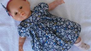 Robe bleu marine pour poupon 36 cm corps souple
