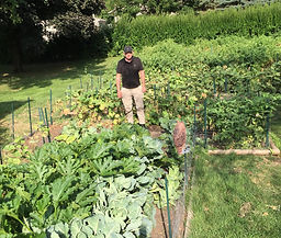 Roger Ginder in his garden.jpg