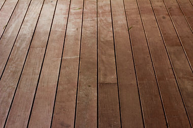 freshly stained backyard deck