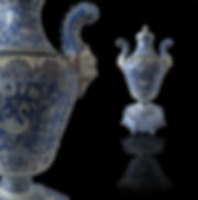 A pair of Italian Baroque Style Covered Vases On Stands, 19th C
