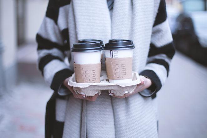 Girl Holding Take-Away Coffee
