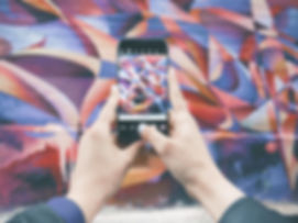 Taking a photo of a mural for social media