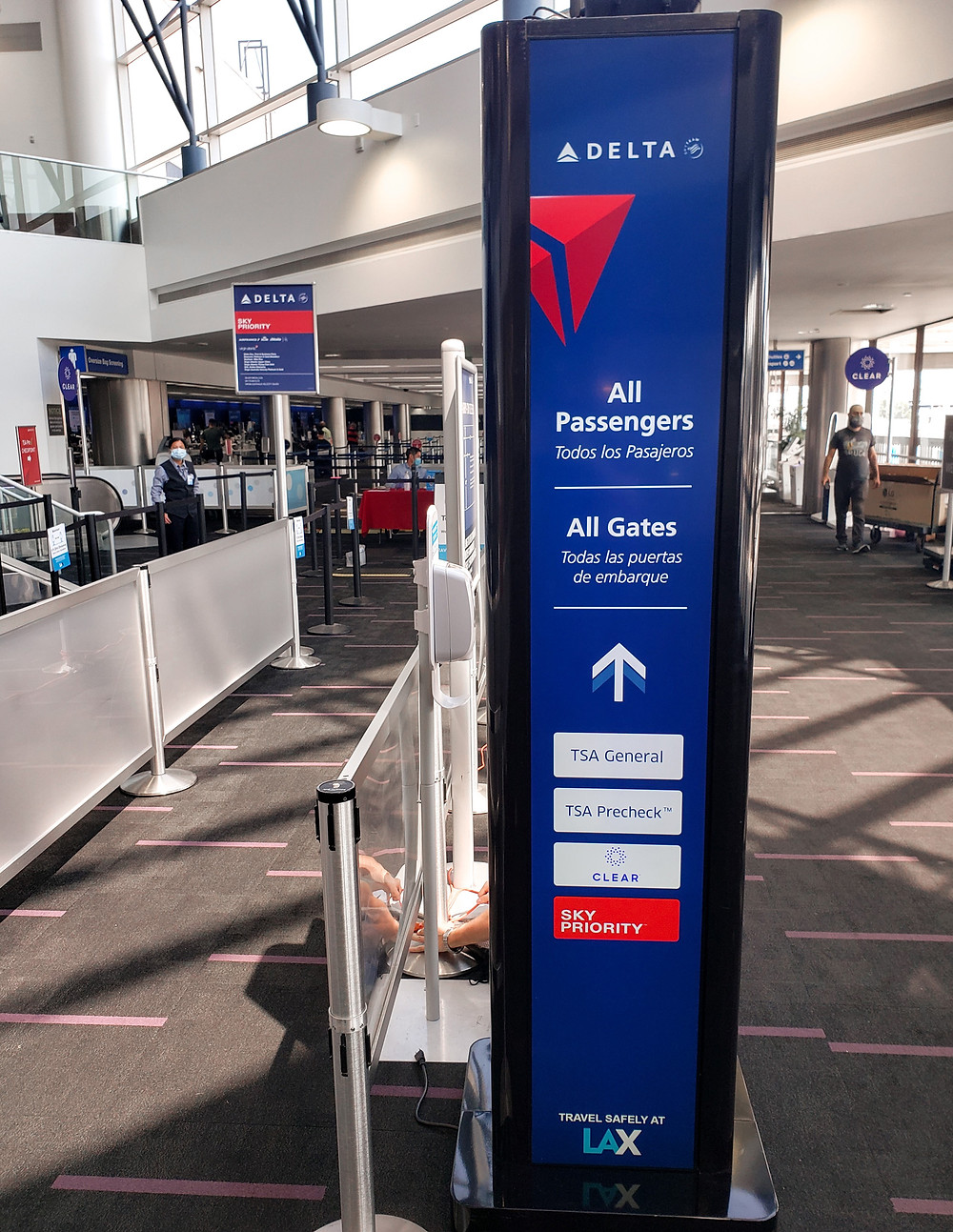 A RreadySeeGo digital signage totem showing digital Delta brand content and airport messaging to passengers