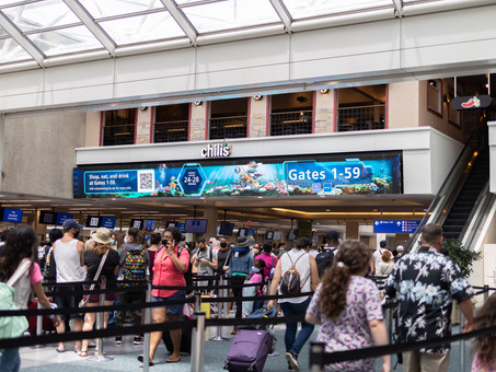Digital Signage Content from MCO and Synect Mesmerizes Passengers at Security