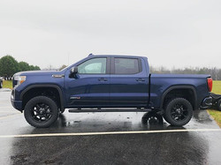"2020 GMC 1500, leveled with 20"" Fuel Cou"