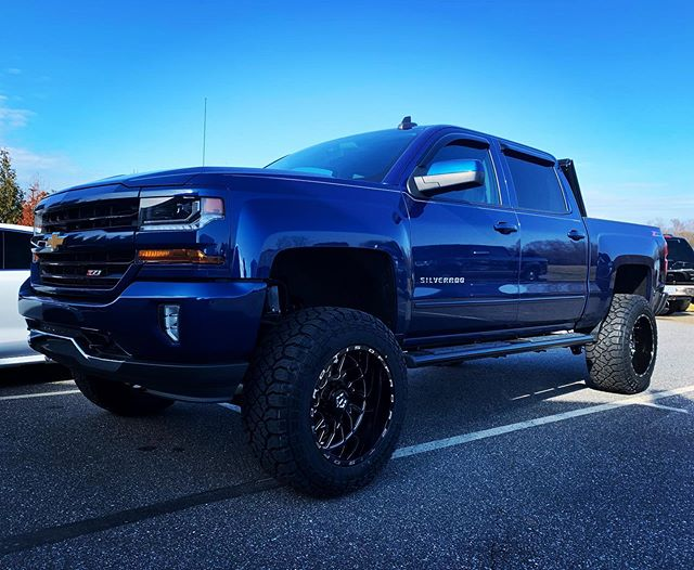"""Chevy 1500 with 7"""" Rough Country Lift, 2"""