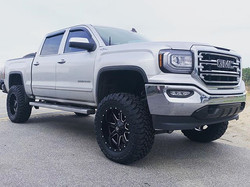 "GMC 1500 with 7"" McGaughy's lift, 20"" Fu"