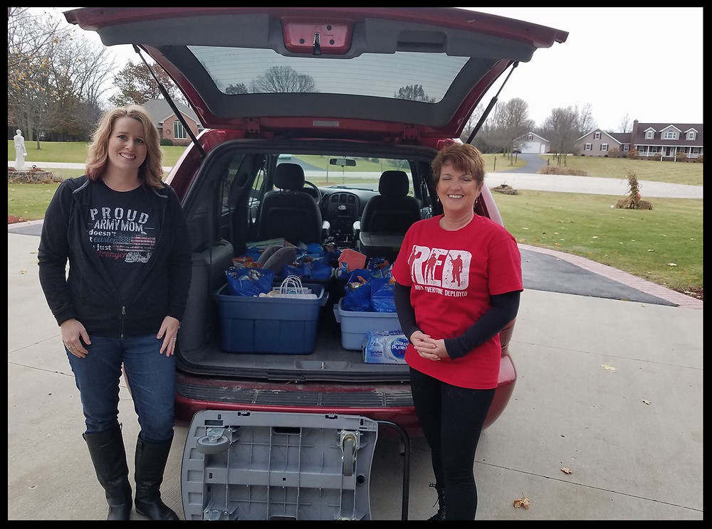 Staci and Patti delivering the bags.