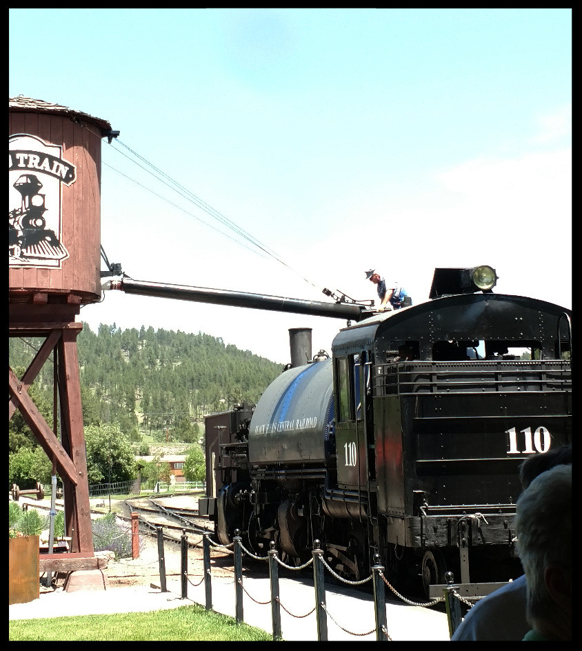 Filling up the water tank for our 1880s train ride.