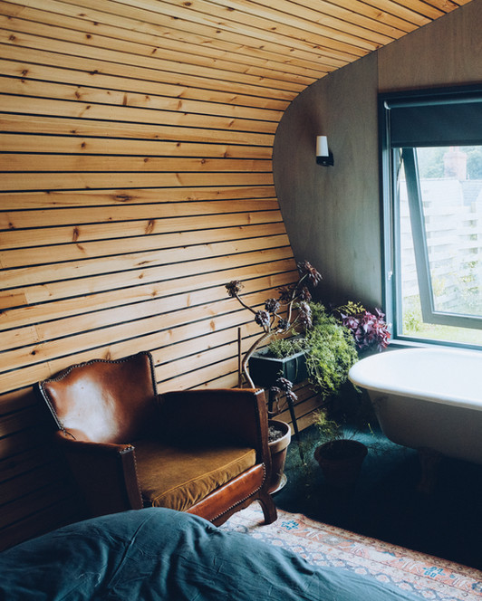 Cabin Interior with Antique Leather Chair and Roll top Bath