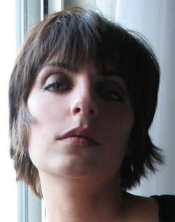 Women's short haircut with a full bang