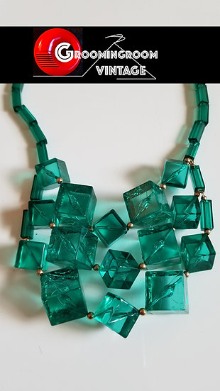 Green ice cube necklace made out of lucite.