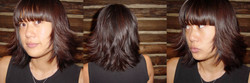 Women's medium length lob with layers and a straight bang