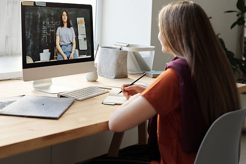 Canva - Girl Watching Video Using Imac.j