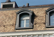 Lucarnes de Morges en cuivre après quelques années. Le cuivre a pris une belle patine brune naturelle.