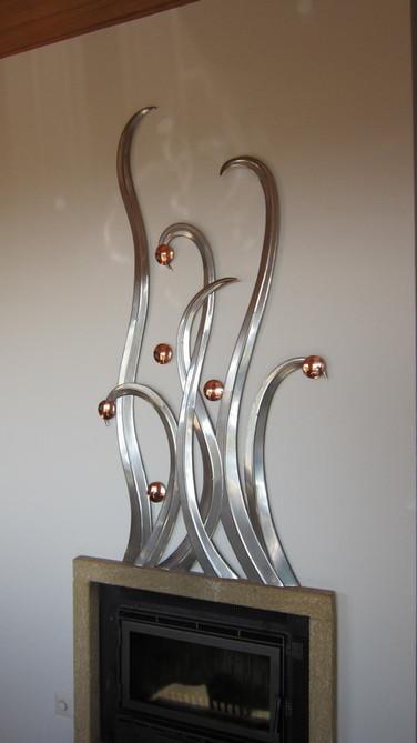 Cheminée après. Création en acier inox et cuivre