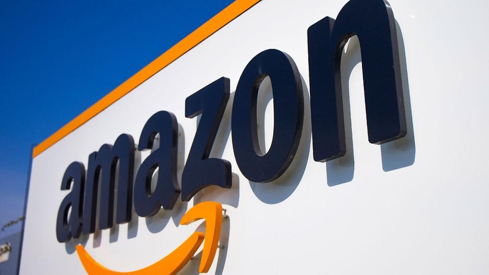 Amazon logo on a warehouse building.