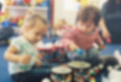Toddlers and two year olds at class learning how to play the drums, keeping in rythym during our beloved music enrichment class. All on the upper west side of manhatta for babies and toddlers!