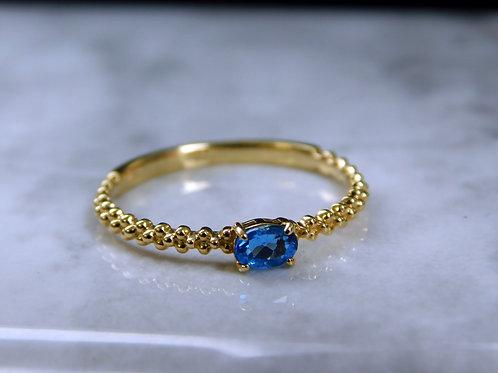 ☆聖なるブルー色アウイナイト☆ アカンサデザインスリング☆肌なじみのよいk18YGイエローゴールド☆