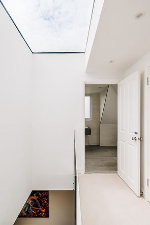 Large flat rooflight over stairs