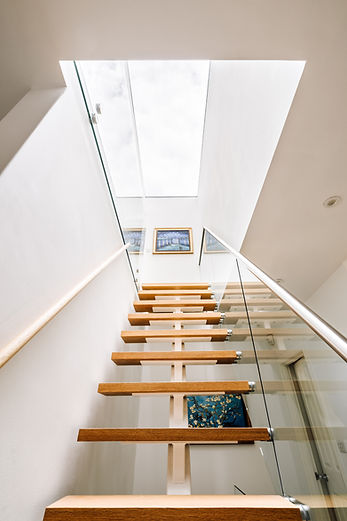Large rooflight over modern stairs