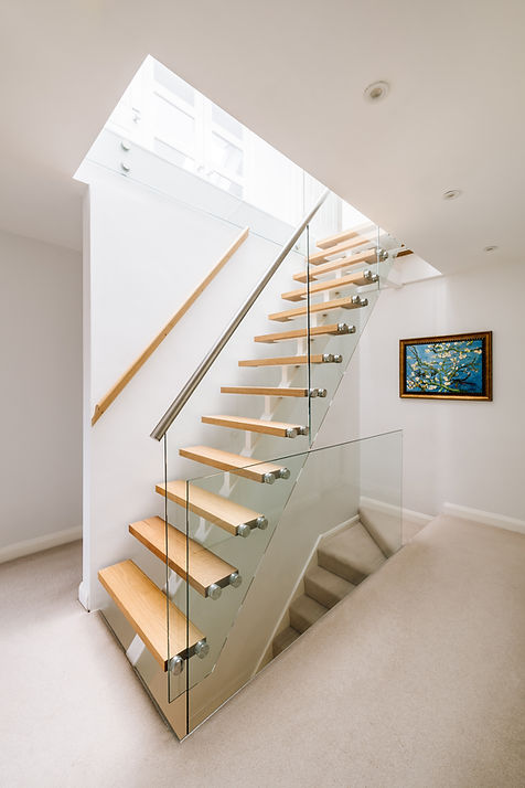 Modern loft conversion with glass stairs