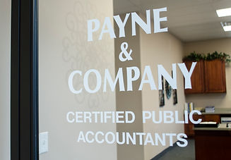 """The words """"Payne & Company Certified Public Accountants"""" printed on the front door of the office."""