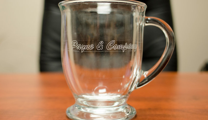 """A glass mug with the words """"Payne & Company"""" Etched into the glass."""