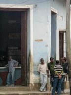 Cuba-men-standing-outside-shop-Trinidad