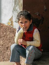Cuba-little-girl-chewing-shirt- Trinidad