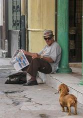 Cuba-newspaper-man-and-daschund-Havana _