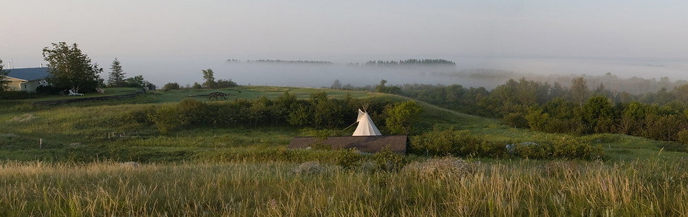 Ancient Spirals Retreat - landscape with fog and tipi
