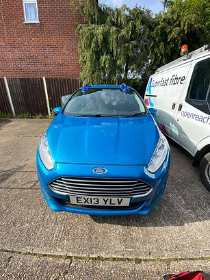 blue ford car with new windscreen.