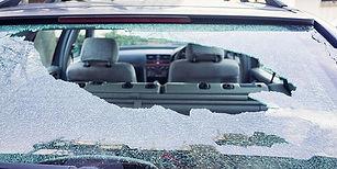 smashed rear car window on a car.