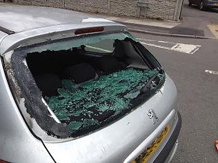 Peugeot 206 smashed rear window.
