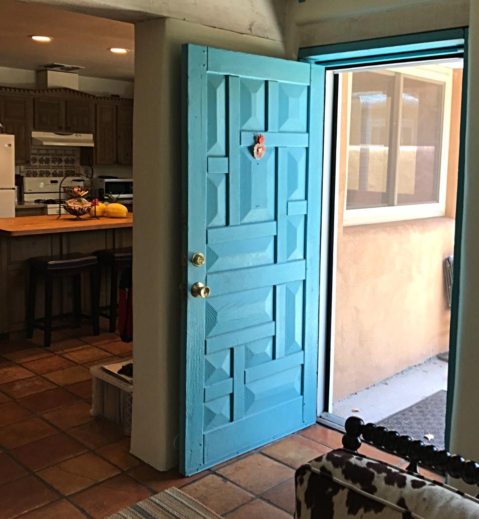 The blue door opens